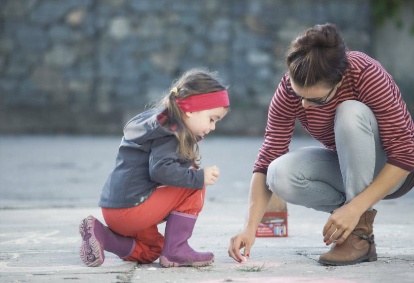 Mother and daughter playing outside - how to explain mosquito bites to your kids